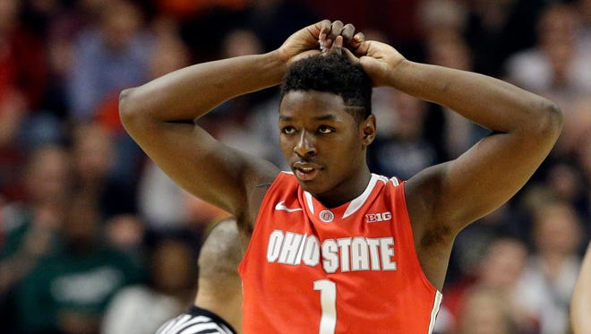 Ohio State's Jae'Sean Tate reacts after being charged with a foul in the first half.