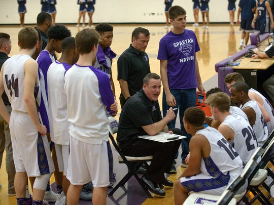 Lakeview head coach Steve Wichmann addresses the Spartans during a third quarter time out.