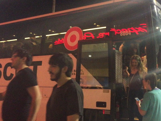 Students exit the shuttle bus to take advantage of