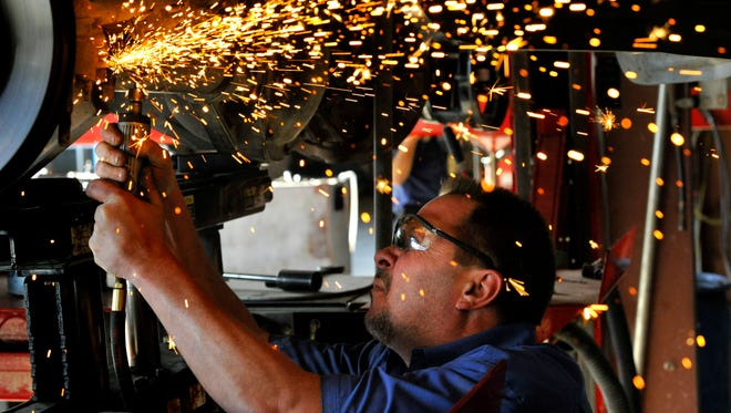 Sparks fly over Dango Griffith as he runs a hand grinder while repairing a F-350 pickup in the Arrow Ford service bay Jan. 9. The Abilene dealership was awarded Small Employer of the Year for 2017 by the Texas Workforce Commission.