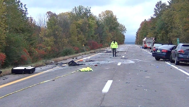 Vermont State Police investigate the scene where a series of crashes on Interstate 89 southbound in Williston closed down the roadway for hours. Five people were killed and five more injured in the incident late Saturday, Oct. 8, 2016.