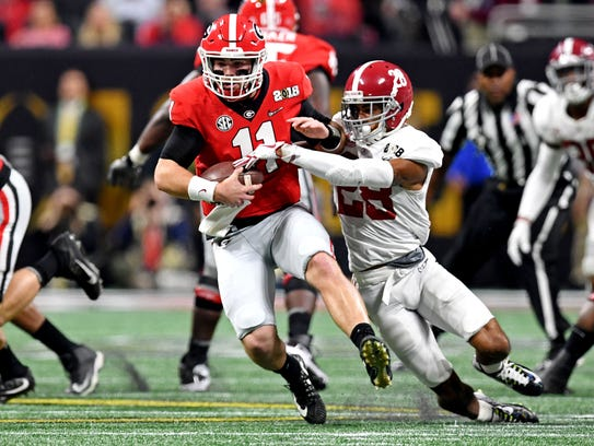 Georgia Bulldogs quarterback Jake Fromm (11) is sacked