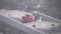A couple on a pedestrian bridge above Interstate 17