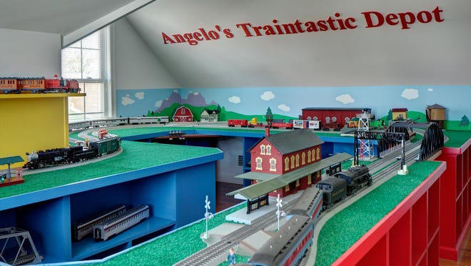 We situated this elaborate train setup along the sloped walls. The center of the room is left open for ease of use and access.