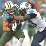 Tennessee Titans safety Michael Griffin (33) tackles Jets wide receiver Eric Decker (87) during the first half on Sunday at LP Field in Nashville.