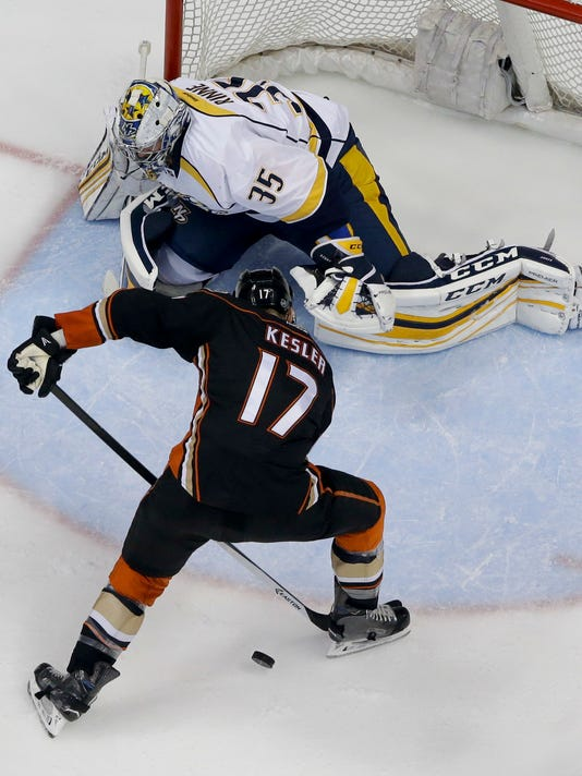 Nashville Predators goalie Pekka Rinne, top, blocks a shot by Anaheim Ducks center Ryan Kesler during the second period of Game 7 in an NHL hockey Stanley Cup playoffs first-round series in Anaheim, Calif., Wednesday, April 27, 2016. (AP Photo/Chris Carlson)