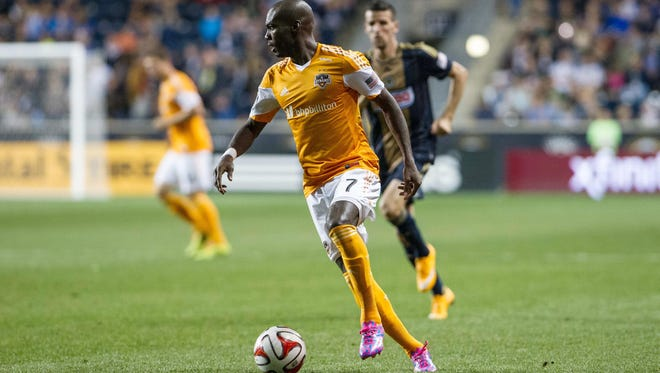 Sep 20, 2014; Chester, PA, USA; Houston Dynamo forward Omar Cummings (7) dribbles the ball during the second half of the match against the Philadelphia Union at PPL Park. The match ended in a 0-0 draw.