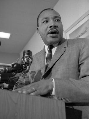 The Rev. Martin Luther King Jr. addresses about 1,000 people at the student union at the University of Wisconsin-Milwaukee on Nov. 23, 1965.