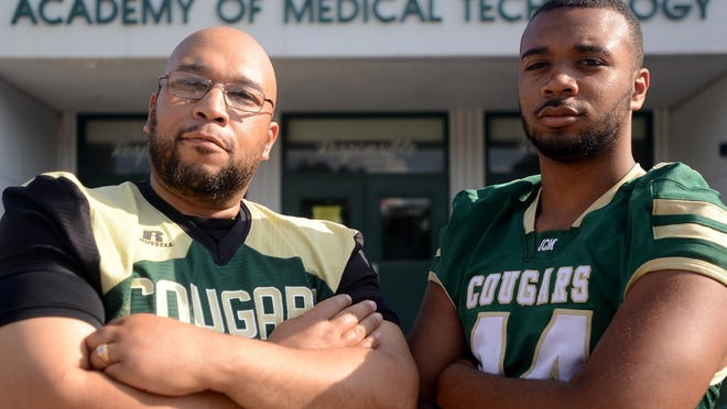 Reggie Davis I, left, and his son Reggie Davis II stand in front of Jackson Central-Merry, where both Davises are a part of the football program's history.