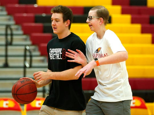 Colten and Logan play basketball before Colten's game