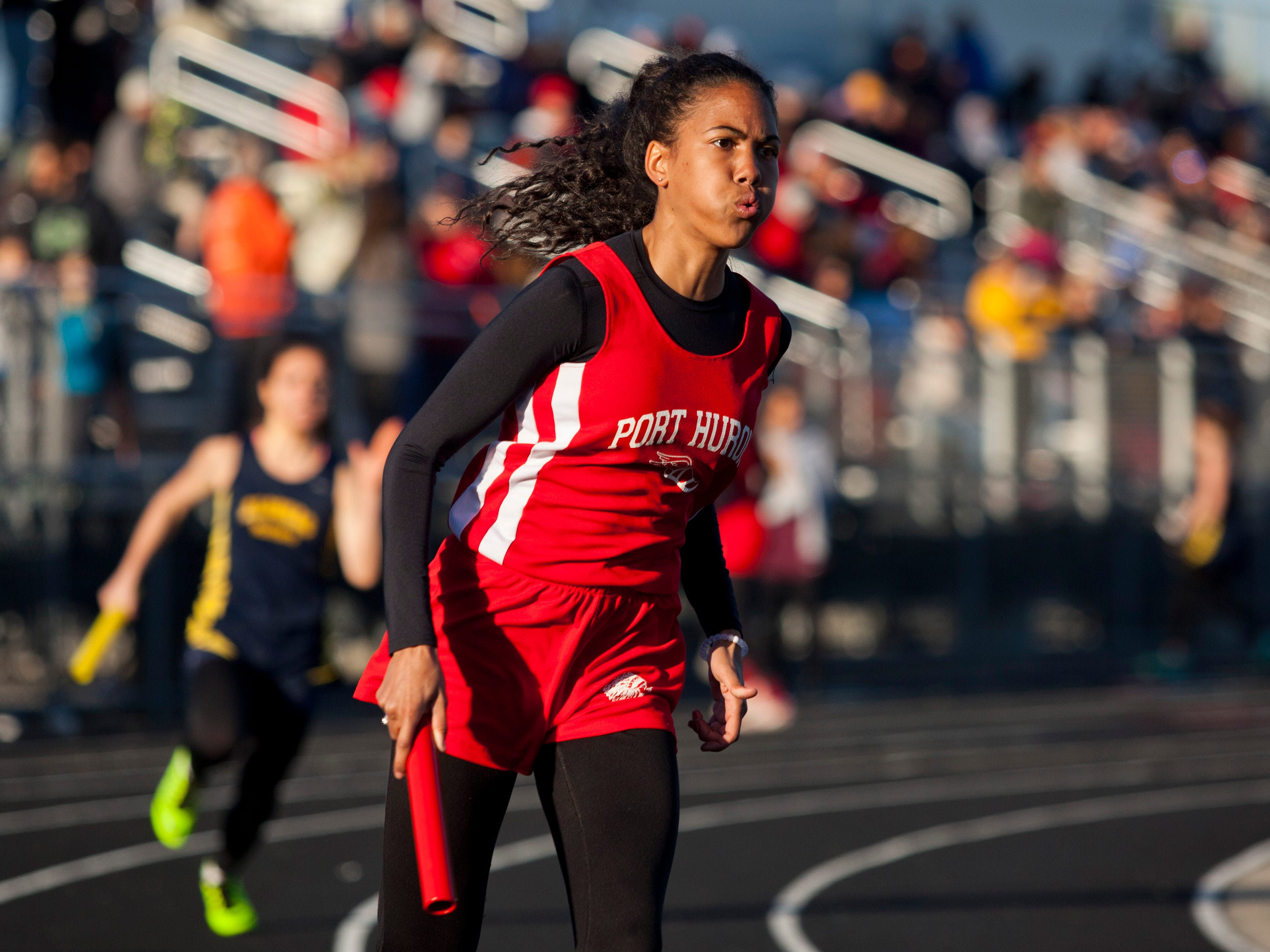 Port Huron sophomore Kelsey Chapman competes in the 400-meter relay during the Meet of Champions Friday, May 22, 2015 at Marysville High School.
