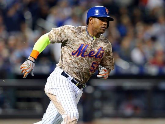 Mets center fielder Yoenis Cespedes hit a double against