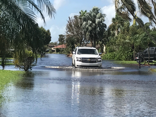 The water crept up Lisa McGarity's driveway and into