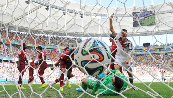 Germany player Thomas Mueller (13) celebrates after a goal past Portugal goalkeeper Rui Patricio during Group G play Monday at the 2014 World Cup at Arena Fonte Nova.