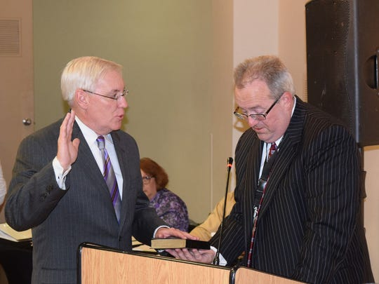 Delaware River Port Authority general counsel Raymond Santarelli (right) administers the oath of office to Joseph S. Martz as a new member of the bistate board's Pennsylvania delegation at a meeting Wednesday at the African American  Museum in Philadelphia.