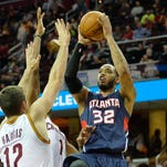 Atlanta Hawks forward Mike Scott (32) shoots against the Cleveland Cavaliers in the fourth quarter at Quicken Loans Arena. Mandatory Credit: David Richard-USA TODAY Sports