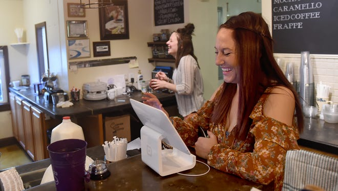 """I couldn't believe it. Really. I was in shock. I thought for sure I was not going to get a job,"" said Emily Bielawa, seen here working the register at Brew Cumberland's Best in New Cumberland. The 26-year-old mother of one was required by her participation in drug court to find a job and has been with the coffee shop for nine months."