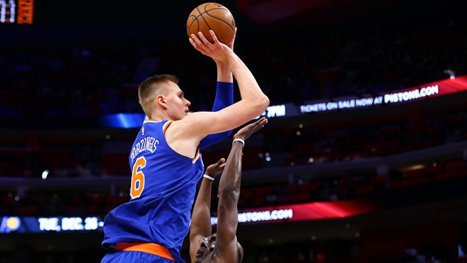 New York Knicks forward Kristaps Porzingis (6) takes a shot against Detroit Pistons forward Anthony Tolliver (43) in the first half at Little Caesars Arena on Friday, Dec. 22, 2017.