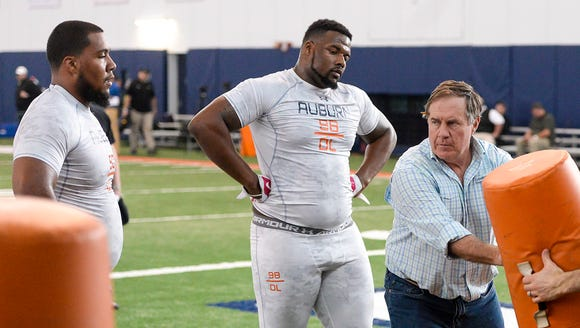 Patriots coach Bill Belichick instructs Gabe Wright