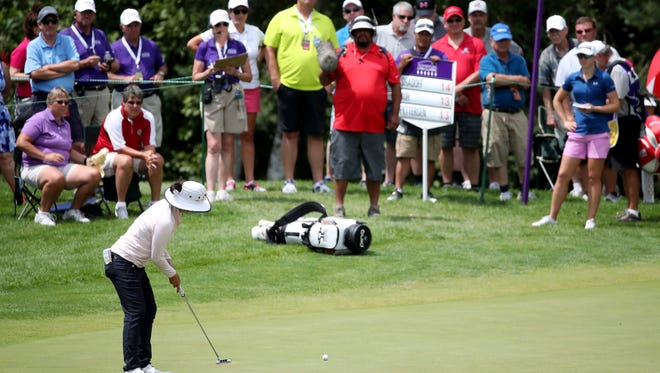Tiffany Joh strokes a birdie putt in front of a large gallery at the sixth green during the final round of the Thornberry Creek LPGA Classic on Sunday in Hobart.