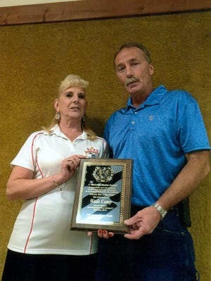 Exalted Ruler Arleen Hickman presented Wade Camp with the J. Malcolm Beebe Award