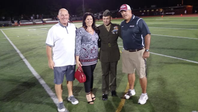 Bloomfield honored the service of John Armellino, a 1986 graduate of the high school and a colonel in the U.S. Marines, during halftime of the Sept. 22 football game with North Bergen.