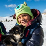 As part of the Alaska itinerary, Disney Cruise Line guests explore Musher's Camp at the Klondike Gold Rush National Historical Park in Skagway. Guests meet the mushers and sled dogs and are whisked on a thrilling ride through Alaska's temperate rainforest by the husky team.