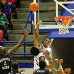 Tech center Michale Kyser swats a rebound away on Thursday night at the TAC in Ruston.