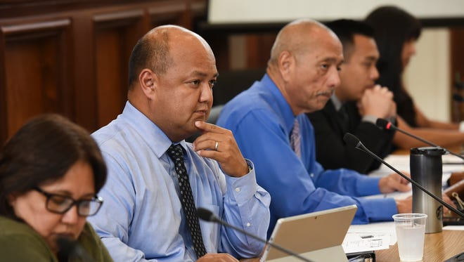 Guam Department of Education Superintendent Jon Fernandez, second from left, during a session at the Guam Congress Building on Aug. 21, 2017.