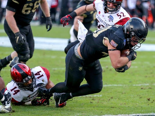 Army running back Andy Davidson gets into the end zone for a touchdown against San Diego State during the first half of the Armed Forces Bowl in an NCAA college football game in Fort Worth, Texas, S (Steve Nurenberg/Star-Telegram via AP)