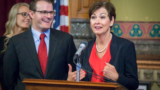 Iowa Gov. Kim Reynolds answers questions on Thursday, May 25, 2017,  after appointing acting Lt. Gov. Adam Gregg, formerly a state's public defender, at the Governor's formal office in the Statehouse.
