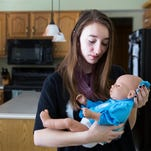 A RealCare Baby at the home of Fairport High School tenth-grader Katie Conlon.