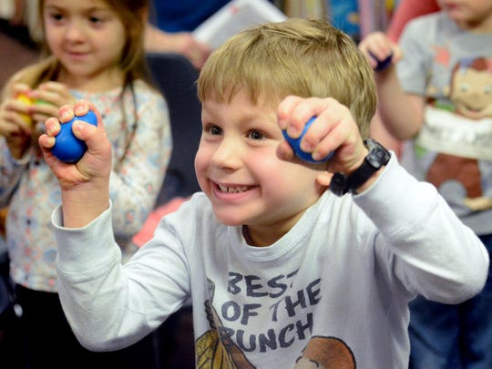 Owen Steinkamp, 4, of Springesttsbury Township, plays shaker eggs during a pre-school story time at Kreutz Creek Library in Hellam Township Friday, Feb. 16, 2018. Storyteller Felicia Gettle, a York County Library System employee says, like many coworkers, her hours have been cut due to funding shortfalls. Bill Kalina photo