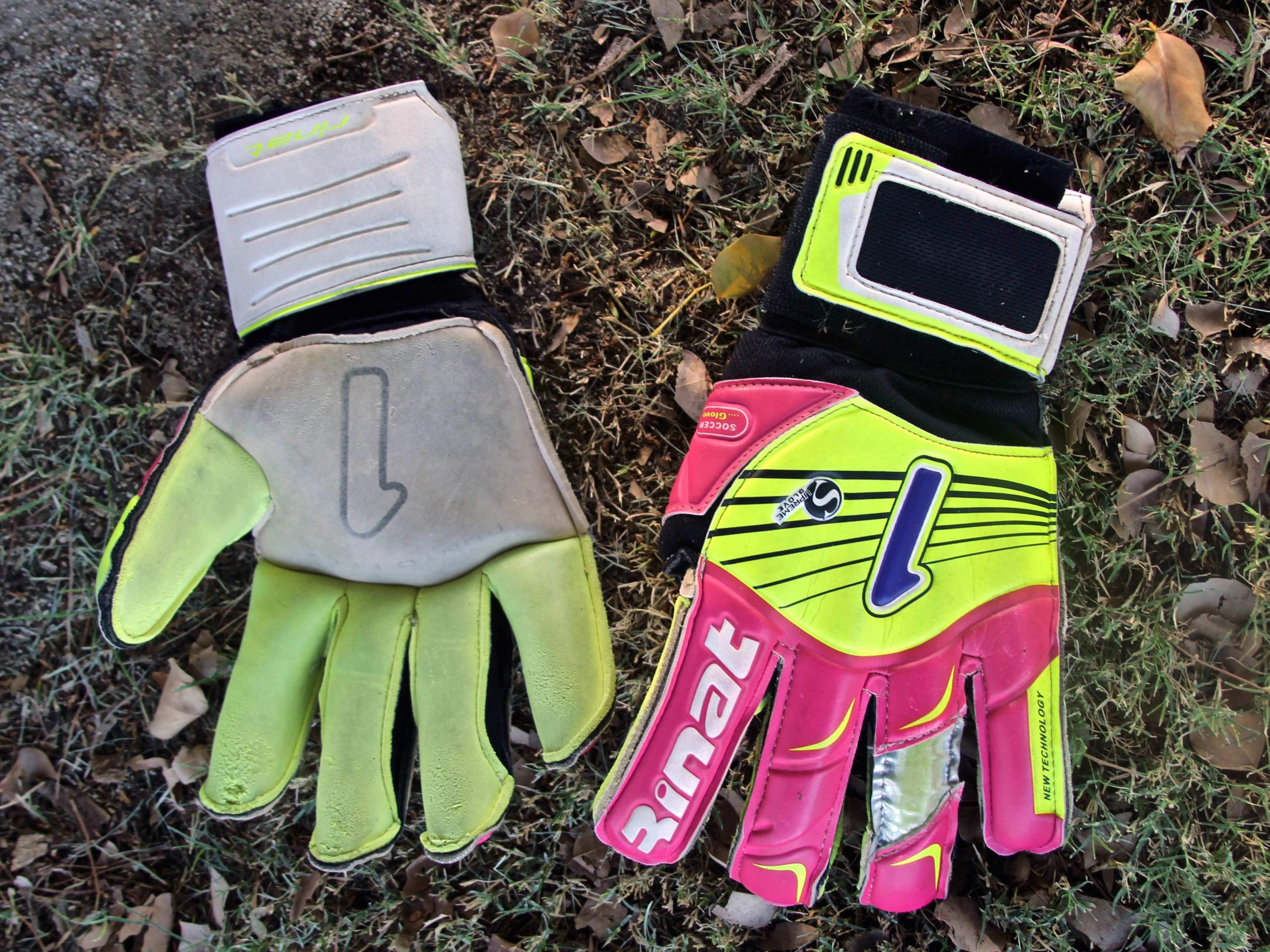 Uriel Lopez's gloves lay on the grass before a soccer practice, Tuesday, at the Hovley Soccer Park in Palm Desert.