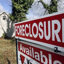 A foreclosure sign is seen at a home in Egg Harbor Township, N.J., in March 2008. A new report shows that Indiana is one of eight states most underserved by federal HAMP loan-modification program. In Indiana, there have been nearly eight foreclosures for each loan modification under the program, compared to the national rate of four foreclosures per modification.