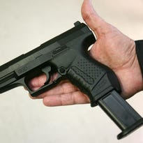 A toy handgun is displayed during a press conference at police headquarters Sept. 16, 2008.