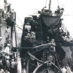 Some of the survivors of the LCI-449. Bill HIldebrand is pictured second from right in first row