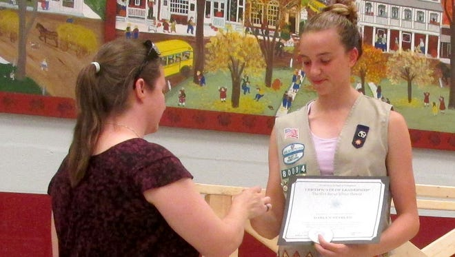 The Girl Scout Silver Award was presented to Daelyn Stabler by Cadette Troop leader Lori Topper.