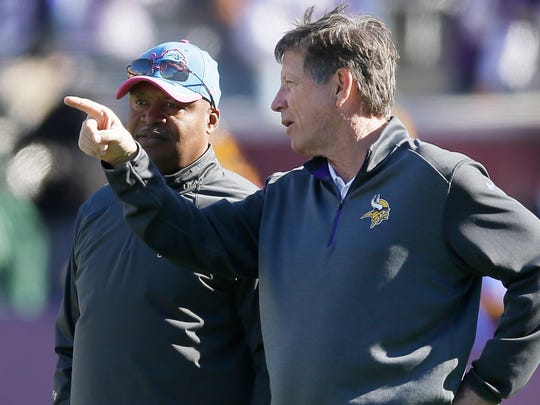 Detroit Lions head coach Jim Caldwell, left, walks with Minnesota Vikings offensive coordinator Norv Turner before an NFL football game Sunday, Oct. 12, 2014, in Minneapolis.