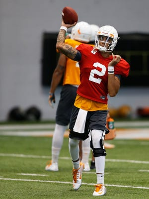 Quarterback Jarrett Guarantano throws to a receiver during practice Thursday, Aug. 31, 2017.