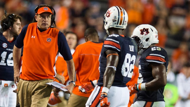 Auburn head coach Gus Malzahn talks to his players during the NCAA football game between Auburn and Mississippi State on Saturday, Sept. 26, 2015, at Jordan-Hare Stadium in Auburn, Ala. Mississippi State Bulldogs defeated Auburn 17-9.Albert Cesare / Advertiser