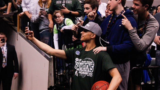 Michigan State's Bryn Forbes poses for a picture after beating Purdue Sunday in Indianapolis.