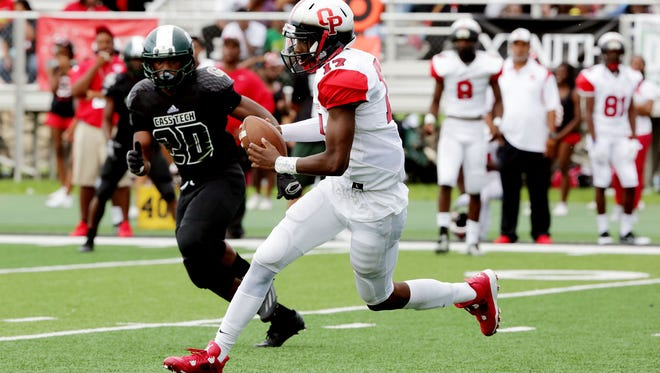 Oak Park's Dwan Mathis (17) runs the ball by Cass Tech's during the second half of the Detroit Prep KickOff Classic Sunday, Aug. 28, 2016 at Wayne State University's Tom Adams football field.Regina H. Boone/Detroit Free Press