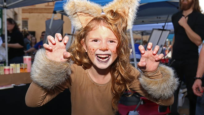 Avery Leck, 6, poses in costume as a lion at the Historic Irvington Halloween Festival street fair, Indianapolis, Saturday, October 29, 2016.