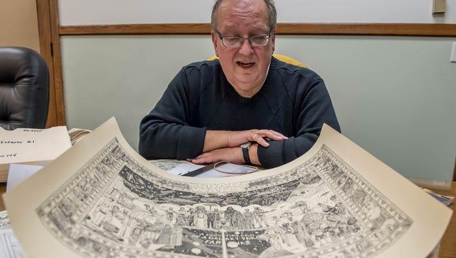 Local historian Kurt Thornton shows some of his Battle Creek memorabilia.