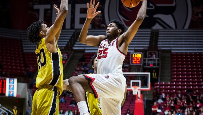 Ball State's Tahjai Teague looks to shoot past Alabama State's defense during their game at Worthen Arena Dec. 22, 2016.