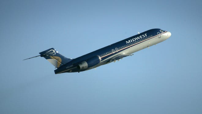 A Midwest Airlines jet takes off from a runway at Mitchell International Airport in this January 2008 photo. Two investors are working on plans to revive the former hometown airline.