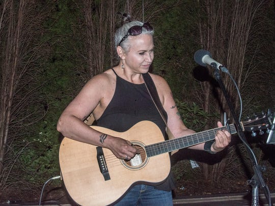 Jilla Webb sings in a solo performance at The Exchange in downtown Montgomery on Oct. 1, 2017.