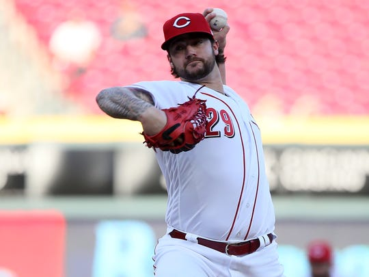 Cincinnati Reds starting pitcher Brandon Finnegan (29) delivers in the first inning during a National League baseball game between the Milwaukee Brewers and the Cincinnati Reds, Monday, April 30, 2018, at Great American Ball Park in Cincinnati.