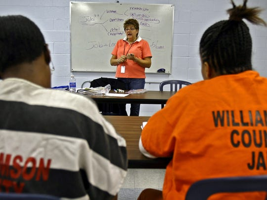 Instructor Meredith Kendall, center, teaches inmates in a job class at Williamson County jail in Franklin in 2010.